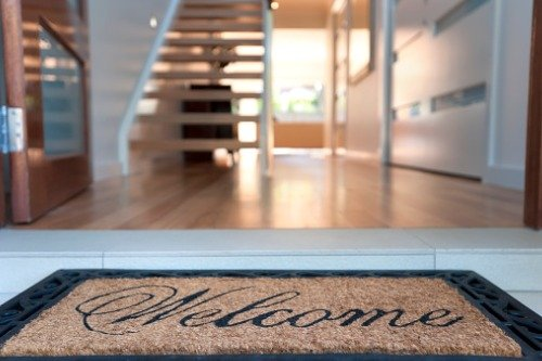 Welcome mat leading into hallway of home