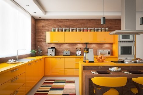 Remodeled kitchen with bright orange yellow accents.
