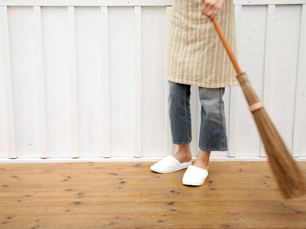 Woman sweeping a floor
