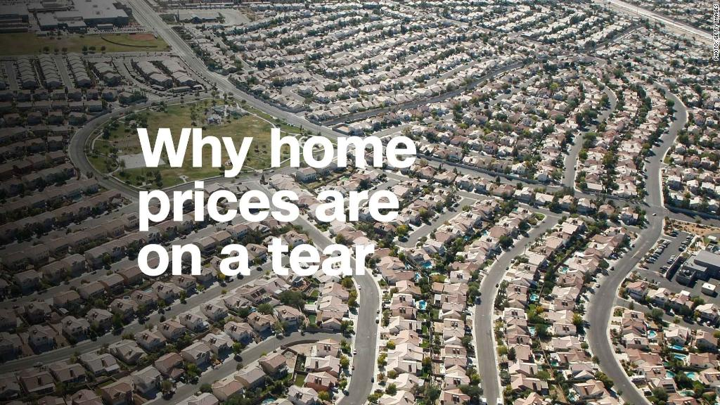 Aerial picture of a residential Neighborhood with the words... Why home prices are on a tear.