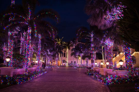 Mansion decorated with many Christmas Lights