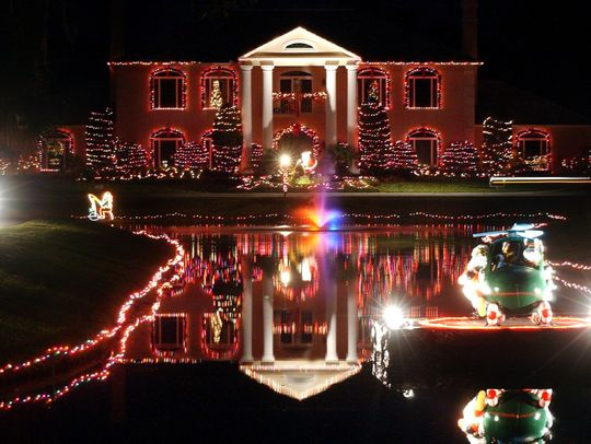 A Picture of Tara Plantation in Vero Beach, Florida decorated with Christmas Lights.