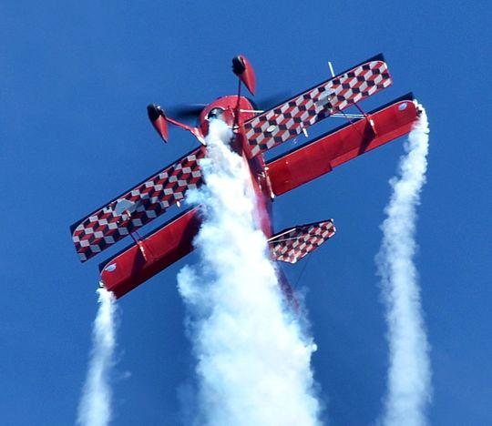 Propeller Classic Airplane performing an aerobatic stunt.