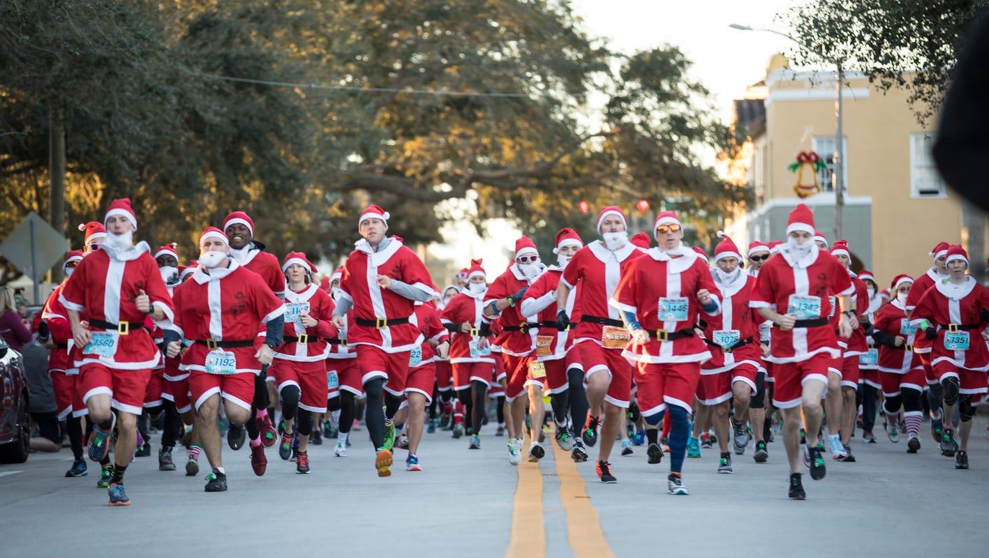 Group of marathon runners all dress as Santa Claus