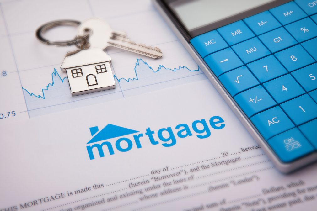 Mortgage Application with a House Key Ring & House and also a Calculator