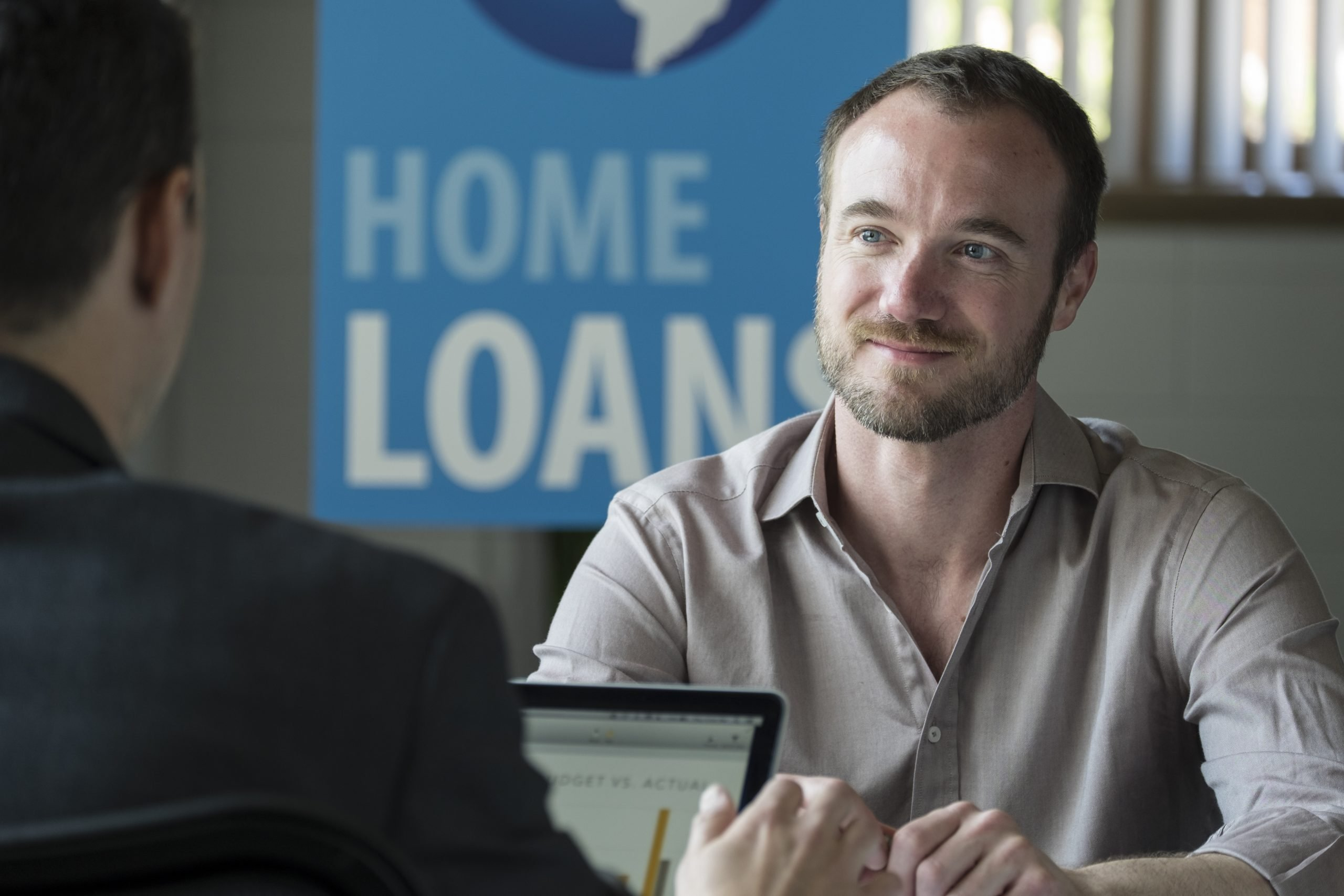 male in a home loans office representing help for homeowners through FHA options