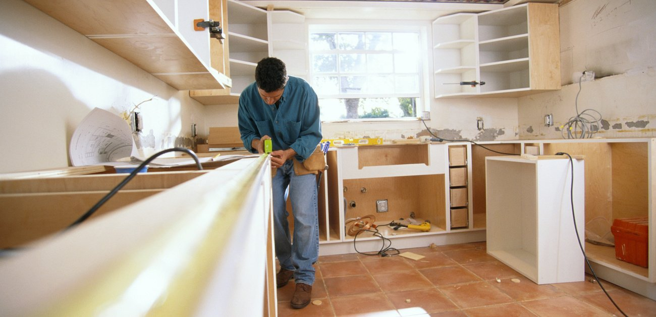 Home Improvement expert works on remodeling a kitchen