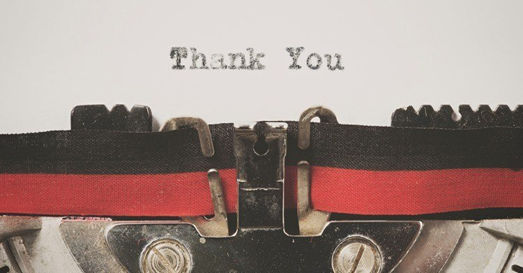 Image of a typerwiter ribbon and the words Thank You typed.