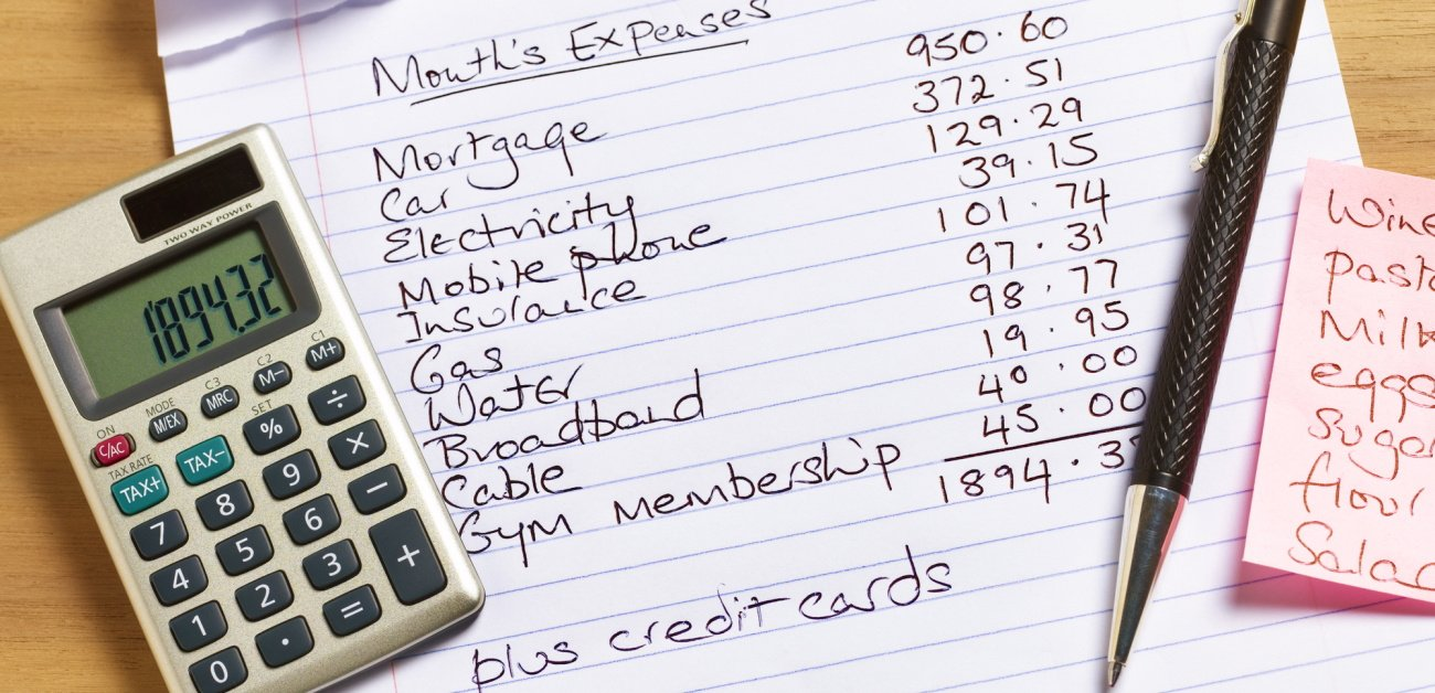 Photograph of a calculator, shopping list, a pen and a household budget representing First-Time Buyers Don't Blow the Budget