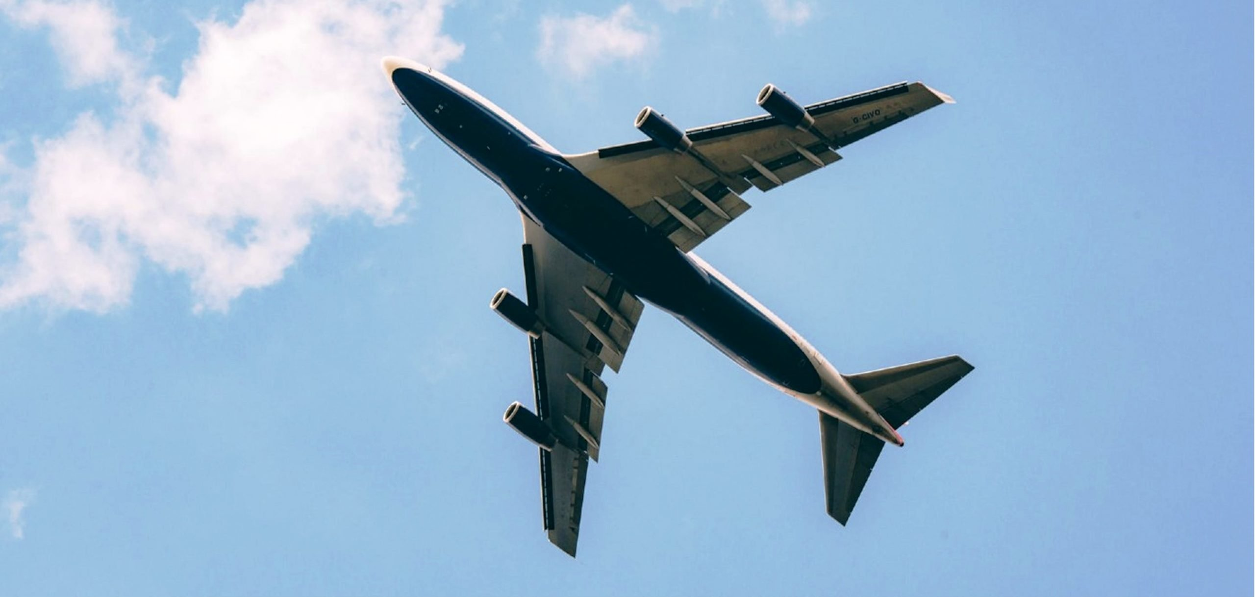 Photograph of an airplane flying overhead.