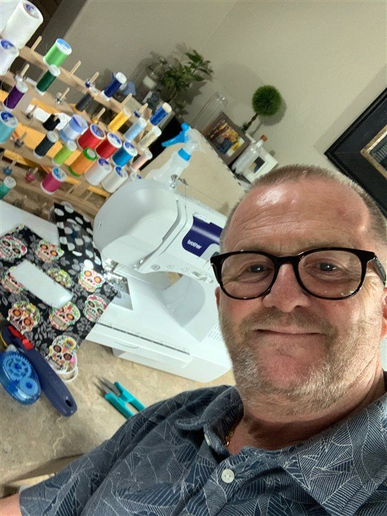 Life without barriers: Picture of Brian Travers who learned this spring how to sew for the first time. He soon transformed his new skills into a way to help people who are deaf and hard of hearing.