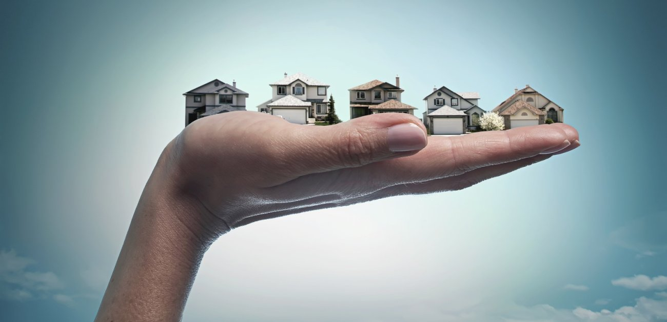 Picture of a hand holding different houses in it's palm representing Why This Fall Is a Big Opportunity for Buyers