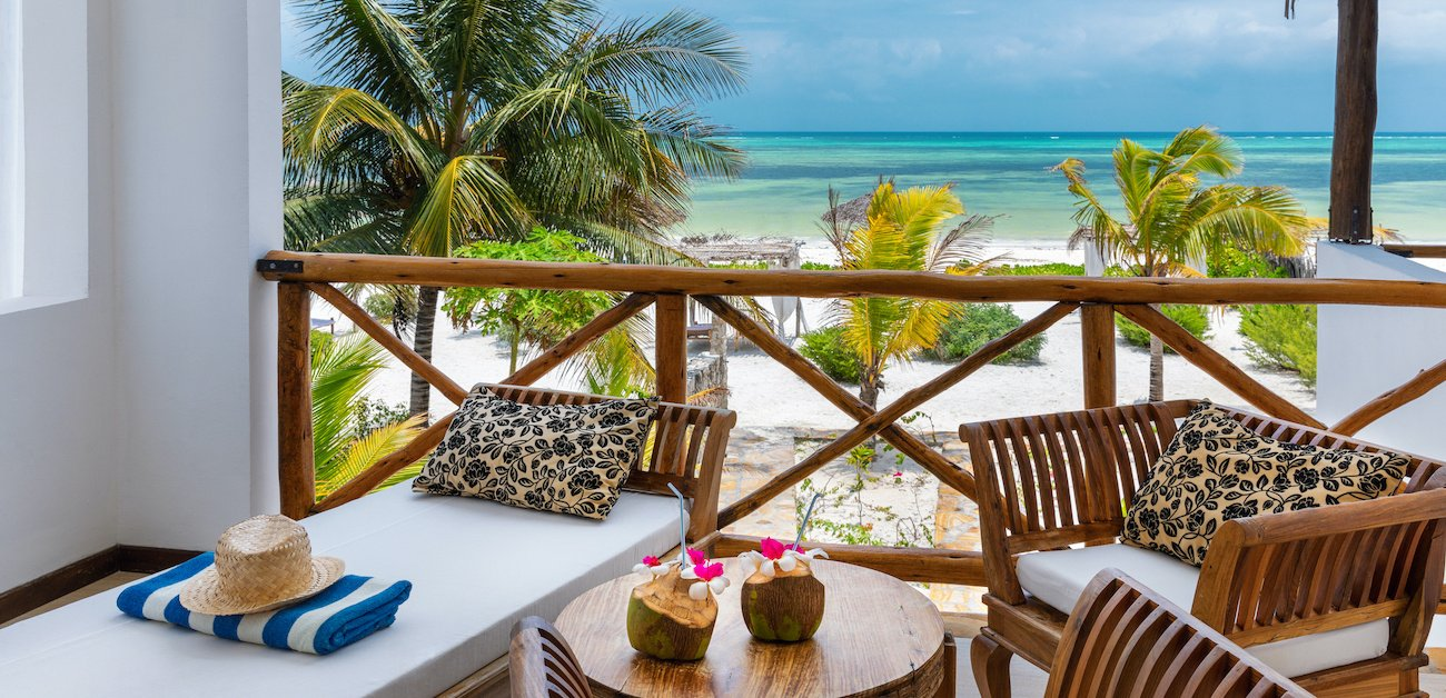 Vacation Homes are a Hot Commodity - Picture of a vacation home balcony overlooking the beach and ocean