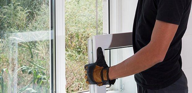 Man installing in a double pane window