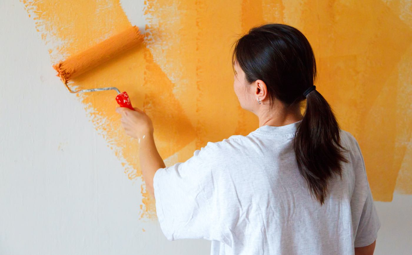 Young Woman working home improvement project by Painting House Wall Public Domain via Need Pix