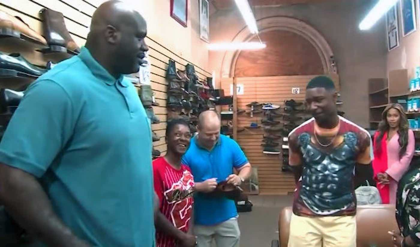 Shaquille O'neal at a show store giving a Teen 10 paris of new size 18 shoes to pay forward childhood good deeds.