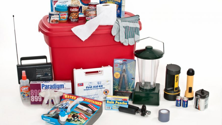 Picture of the items that should be in a typical hurricane emergency kits. Items include Raiod, lanterns, gloves, batteries, first aid, tissue and food among others.