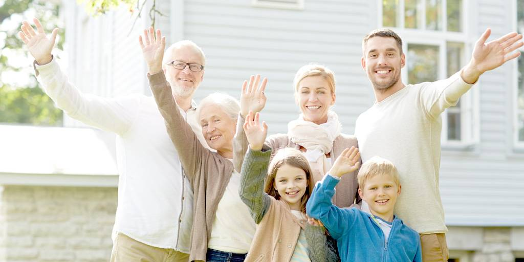 mortgage appraisal - property appraisal - happy family waving hands in front of home