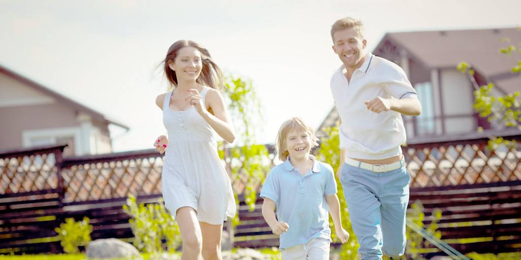 mortgage - mortgage refinancing - family running in backyard