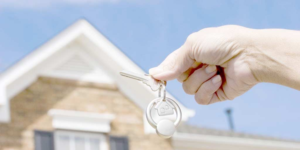 mortgage - Florida mortgage - hand holding keys in front of a key