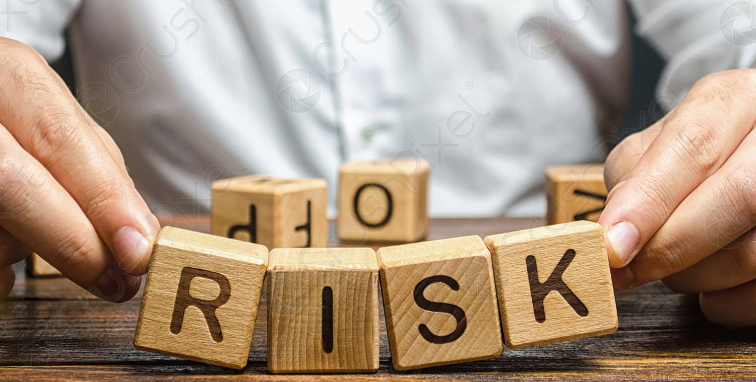 man holds blocks with the word risk to represent 4 ways to reduce risk amid multiple offers