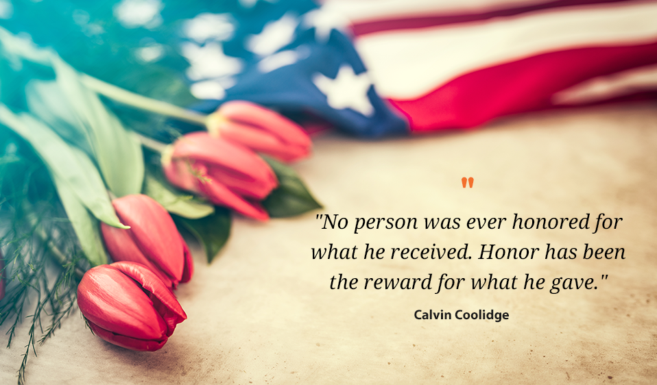 Picture with an American Flag, Tulips and Calvin Coolidge Quote: No persona was ever honored for what he received. Honor has been the reward for what he gave.