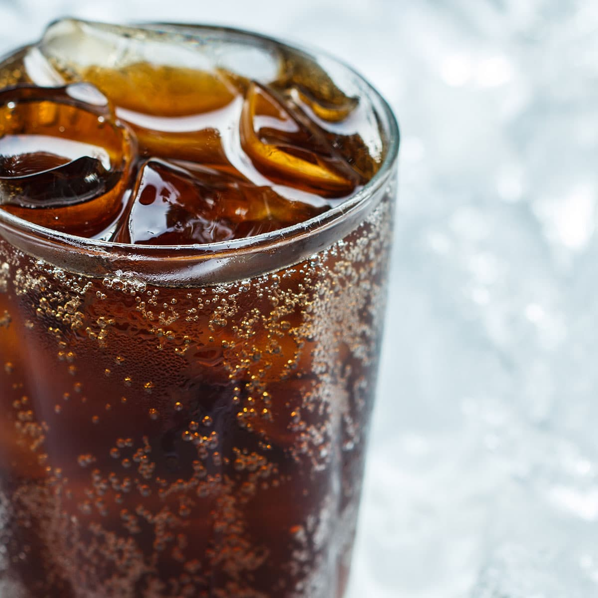Picture of a glass of cola with ice for National Have a Coke Day.