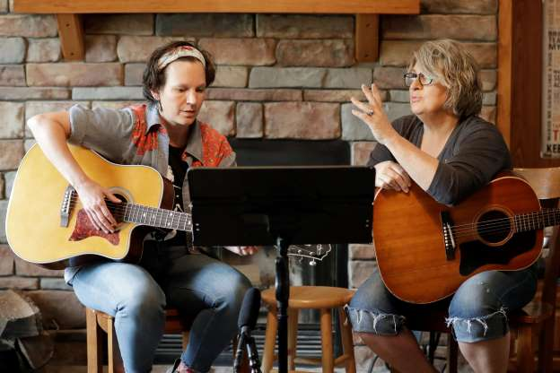 Picture of nurse Megan Palmer and care partner Anna Henderson, from Vanderbilt University Medical Center, appear during a songwriting session