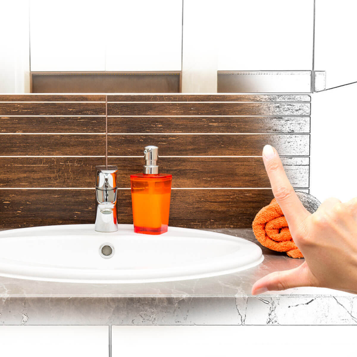 Bathroom sink with an orange towel and soap dispenser. A woman's fingers are framing it out.