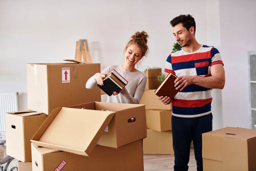 young-couple-moving-in-to-house - representing 2021 Generational Trends