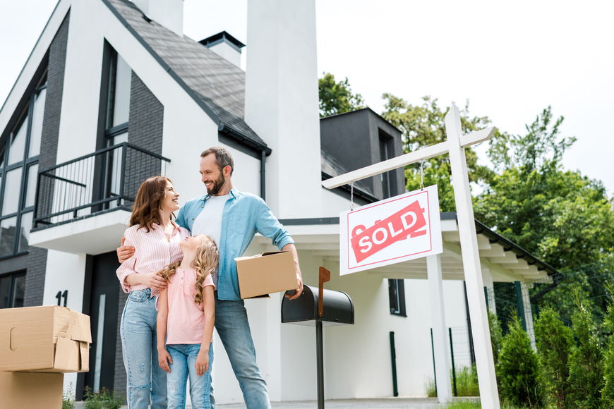 young family moving into their new home representing the FLORIDA HOUSING MARKET and MEDIAN PRICES, NEW LISTINGS UP IN AUGUST